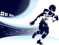 Football Player. Running with ball in a stadium Royalty Free Stock Photo