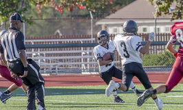Football Player Running To Get A Touchdown  Stock Photography