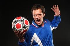 Football player screaming at ball Royalty Free Stock Photography