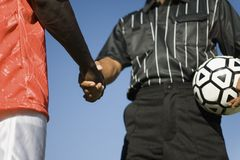 Football Player Shaking Hand With Referee Stock Photography
