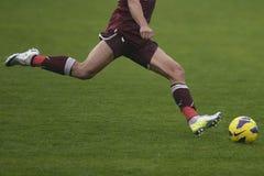 Football player shooting ball Stock Image