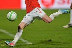 Football player shooting ball Stock Photos