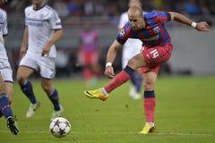 Football player shooting ball Royalty Free Stock Image