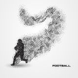 Football player of a silhouette from particle Stock Images