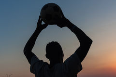 Football Player Silhouetted Throw Stock Photography