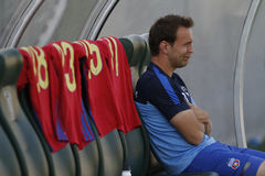 Football player sitting on the bench Stock Images