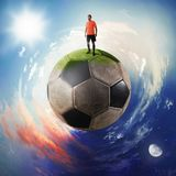 Football player in a soccer ball planet stock photography