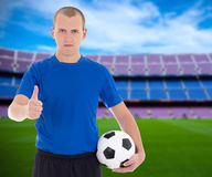 Football player with soccer ball posing on field of stadium Stock Photos