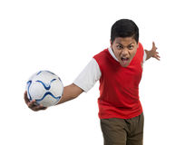 Football player or soccer player showing aggression Royalty Free Stock Photography