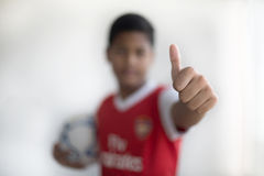 Football player or soccer player showing thumbs up sign Stock Photo
