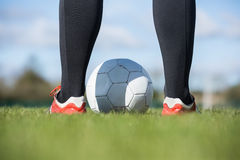Football player standing with the ball Stock Images