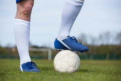 Football player standing with the ball Royalty Free Stock Photo