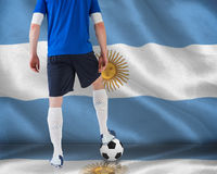 Football player standing with ball Stock Photos