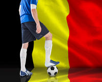Football player standing with ball Stock Photo