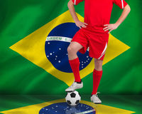 Football player standing with ball Royalty Free Stock Photography