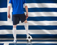 Football player standing with ball Stock Photography