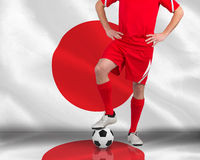 Football player standing with ball Royalty Free Stock Photos