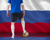Football player standing with ball Royalty Free Stock Photo