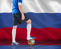 Football player standing with ball Royalty Free Stock Images