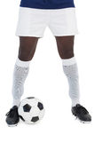 Football player standing with the ball Royalty Free Stock Image