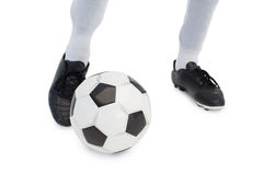 Football player standing with the ball Stock Photography