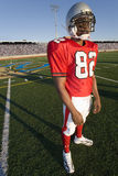 Football player standing on field Royalty Free Stock Photo