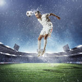 Football player striking the ball Stock Images