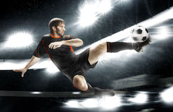 Football player striking the ball Stock Photo
