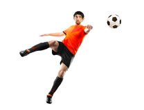 Football player striking the ball, isolated. Football player in orange shirt striking the ball at the white background royalty free stock photo