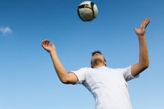 Football player striking the ball at the stadium Royalty Free Stock Photography