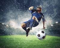 Free Football Player Striking The Ball Royalty Free Stock Photography - 29641687