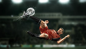Free Football Player Striking The Ball At The Stadium Royalty Free Stock Photography - 36493407