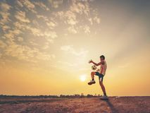 Football player with sunset or sunrise. Background Royalty Free Stock Photos