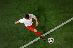 Football player tackling ball over green grass background royalty free stock images