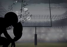 Football player thinking silhouette in the field with text around head. Digital composite of football player thinking silhouette in the field with text around Royalty Free Stock Images