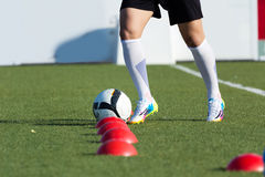 Football player training on the outdoors field Royalty Free Stock Images
