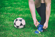 Football player tying his shoes. Royalty Free Stock Photo