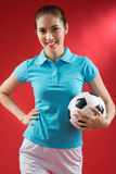 Football player. Vertical portrait of a female football player smiling and looking at camera Royalty Free Stock Image