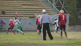 Football player violates game rules, referee making unsportsmanlike conduct sign. Stock footage stock video