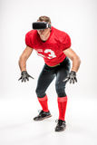 Football player in virtual reality headset stock images