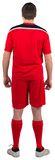 Football player wearing red gear Royalty Free Stock Image