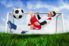 Football player in white kicking the ball Stock Images