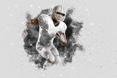 Football Player. With a White uniform coming out of a blast of smoke Stock Photos