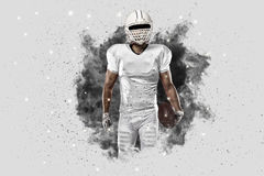 Football Player. With a White uniform coming out of a blast of smoke stock images