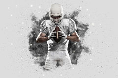 Football Player. With a White uniform coming out of a blast of smoke royalty free stock photos
