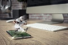 Football Player with a white uniform playing and coming out of a stock images