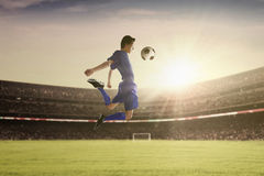 Football player withstand a ball Royalty Free Stock Photos