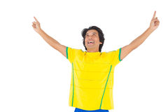 Football player in yellow celebrating a victory Royalty Free Stock Photos