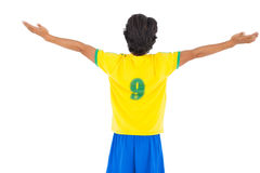 Football player in yellow celebrating a victory Stock Image