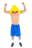 Football player in yellow celebrating a victory Stock Photo